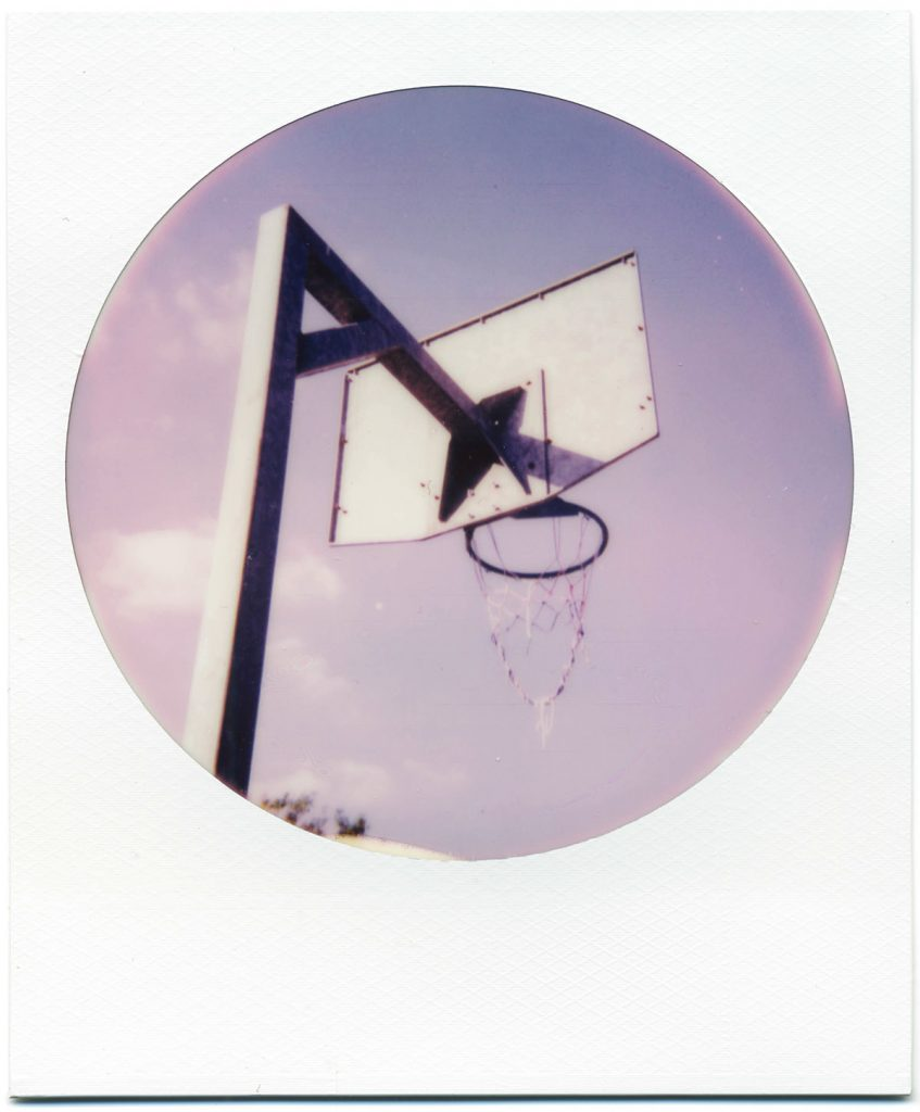 Basket ball hoop shot on Polaroid 600 Round Frame Film Review.