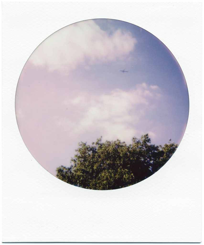 Polaroid 600 Color Round Frames Instant Film Review. Airplane above Ruskin Park